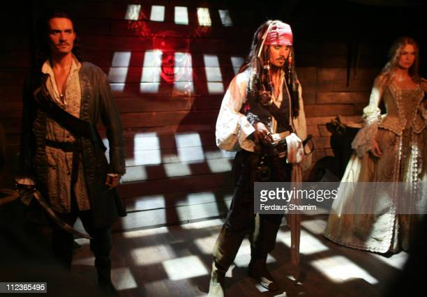 Orlando Bloom as Will Turner Johnny Depp as Jack Sparrow and Keira Knightley as Elizabeth Swann waxwork