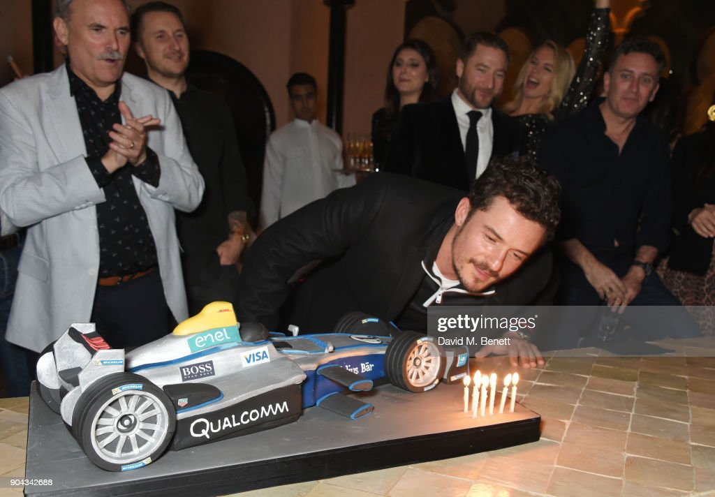 Orlando Bloom (C) blows out the candles of his birthday cake as father Colin Stone and friends Scott Campbell, Andres Faucher and FIA Formula E CEO Alejandro Agag look on at Orlando Bloom's birthday party with ABB FIA Formula E Championship at Hotel Amanjena on January 12, 2018 in Marrakech, Morocco.
