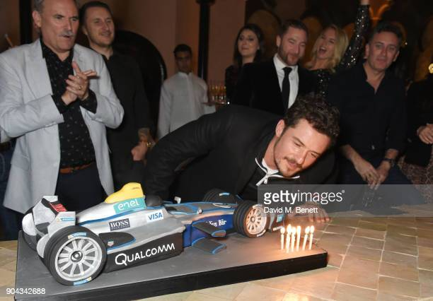 Orlando Bloom blows out the candles of his birthday cake as father Colin Stone and friends Scott Campbell Andres Faucher and FIA Formula E CEO...
