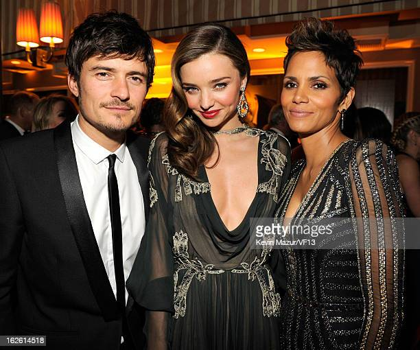 Orlando Bloom Miranda Kerr and Halle Berry attend the 2013 Vanity Fair Oscar Party hosted by Graydon Carter at Sunset Tower on February 24 2013 in...