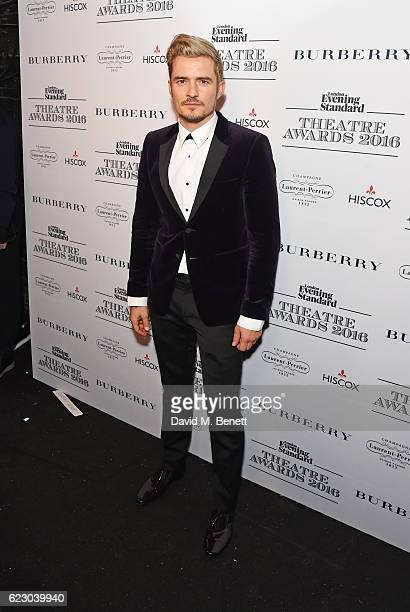Orlando Bloom poses in front of the winners boards at The 62nd London Evening Standard Theatre Awards recognising excellence from across the world of...