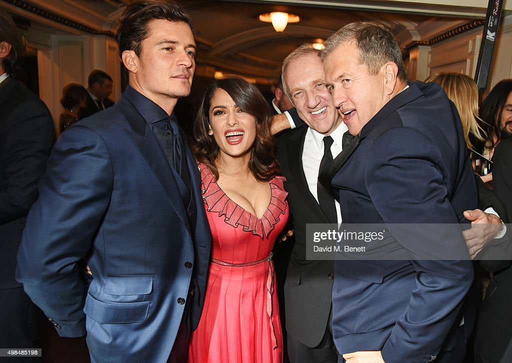 Orlando Bloom, Salma Hayek, Francois-Henri Pinault and Mario Testino attend the British Fashion Awards in partnership with Swarovski at the London Coliseum on November 23, 2015 in London, England.