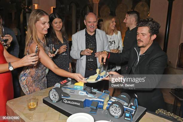 Orlando Bloom serves birthday cake to guests at his birthday party with ABB FIA Formula E Championship at Hotel Amanjena on January 12 2018 in...