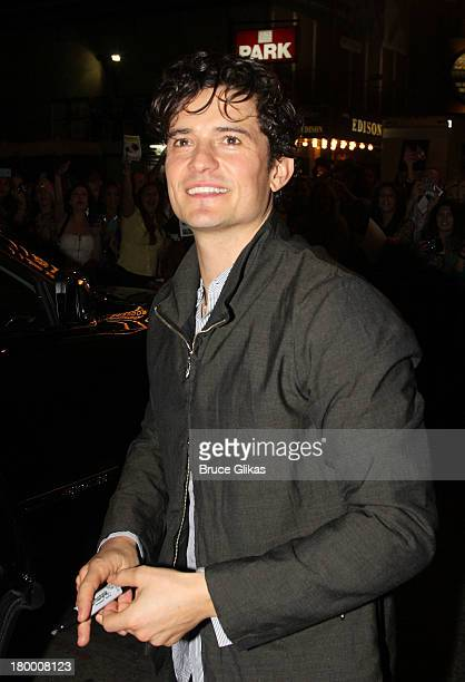 Orlando Bloom signs autographs and meets his fans after his performance in 'Romeo and Juliet' on Broadway at The Richard Rogers Theater on September...