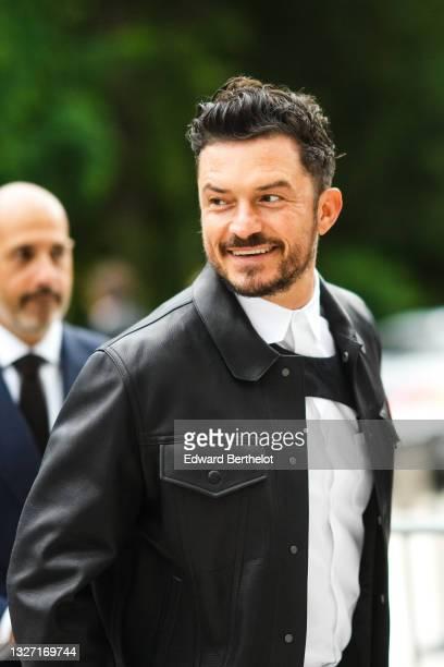 Orlando Bloom wears a black leather jacket, a white shirt, outside Louis Vuitton Parfum hosts dinner at Fondation Louis Vuitton, during Paris Fashion...
