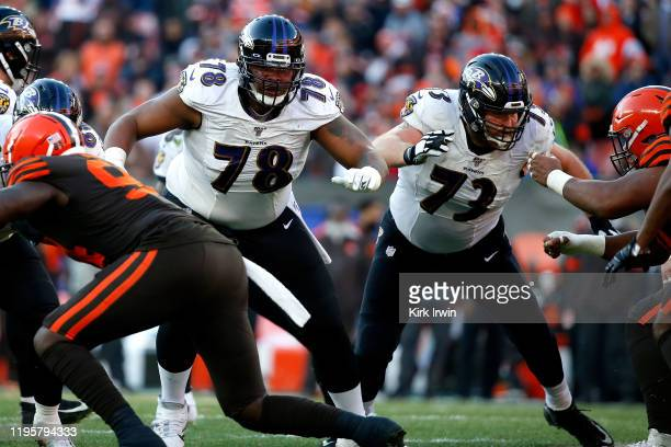 Orlando Brown Jr #78 of the Baltimore Ravens and Marshal Yanda look to make blocks during the game against the Cleveland Browns at FirstEnergy...