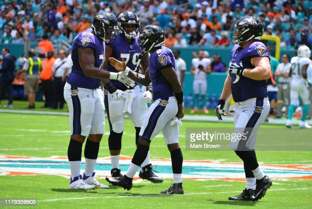Orlando Brown Ronnie Stanley Lamar Jackson and Marshal Yanda of the Baltimore Ravens celebrate a touchdown against the Miami Dolphins at Hard Rock...