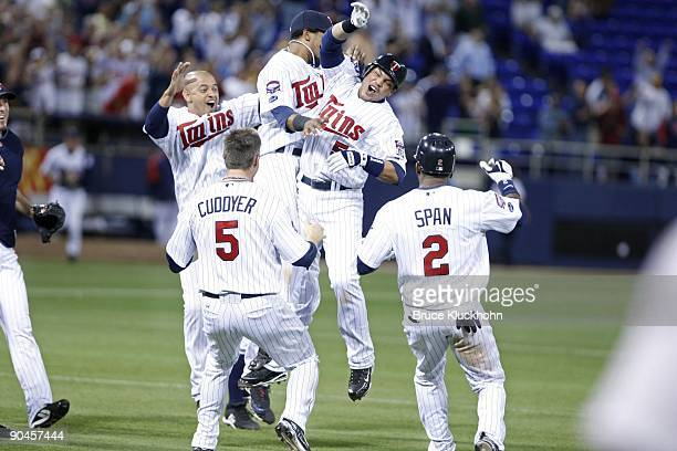 Orlando Cabrera , Alexi Casilla , Michael Cuddyer, and Denard Span join Jose Morales of the Minnesota Twins as he celebrates after he made the game...
