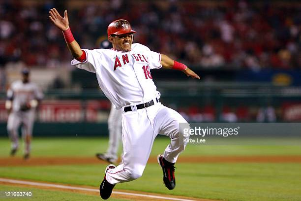 Orlando Cabrera of the Los Angeles Angels of Anaheim slides safely into home plate to score in the sixth inning of 53 loss to the Washington...