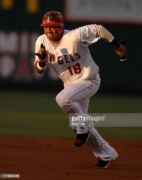 Orlando Cabrera of the Los Angeles Angels of Anaheim sprints toward third base during 124 loss to the Kansas City Royals ini Major League Baseball...