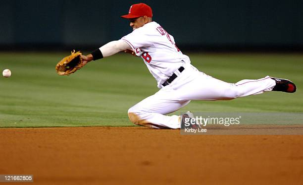 Orlando Cabrera of the Los Angeles Angels of Anaheim stretches for a ground ball during 109 victory over the Houston Astros in Major League Baseball...