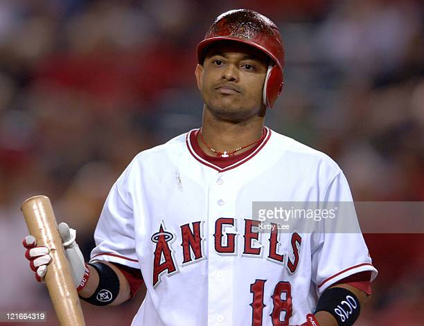 Orlando Cabrera of the Los Angeles Angels of Anaheim walks off the field dejectedly after striking out for the final out of 52 loss to the Texas...