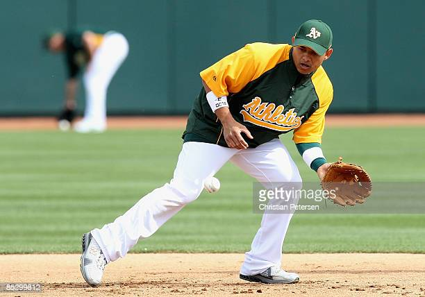 Orlando Cabrera of the Oakland Athletics warms up in the infield before the spring training game against the Cleveland Indians at Phoenix Municipal...
