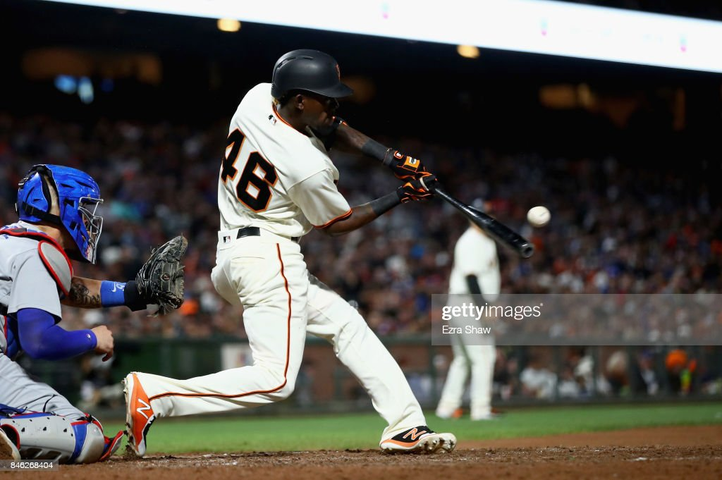 Orlando Calixte #46 of the San Francisco Giants hits an sacrifice fly in the sixth inning that scored Hunter Pence #8 against the Los Angeles Dodgers at AT&T Park on September 12, 2017 in San Francisco, California.