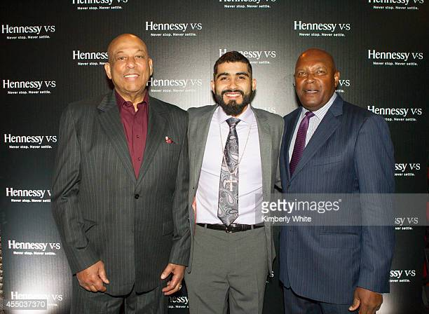 Orlando Cepeda and Sergio Romo and Vida Blue of the San Francisco Giants pose for a photograph at Infusion Lounge on September 8 2014 in San...