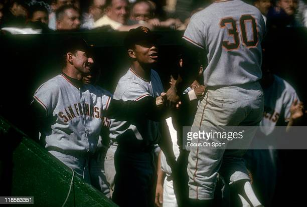Orlando Cepeda of the San Francisco Giants celebrates with teammates after hitting a home run against New York Mets during a Major League Baseball...