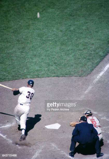 Orlando Cepeda of the San Francisco Giants puts the ball in play during an MLB game against the Cincinnati Reds circa August 1962 at Candlestick Park...