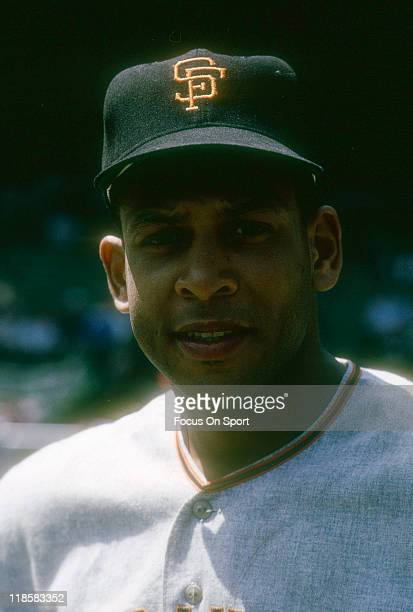 Orlando Cepeda of the San Francisco Giants smiles for the camera before the start of a Major League Baseball game against the New York Mets circa...