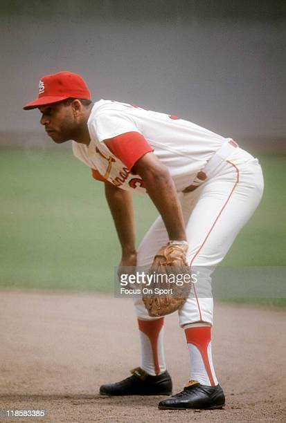 Orlando Cepeda of the St Louis Cardinals with hands on knees is ready to make a play on the ball during a Major League Baseball game circa 1967 at...
