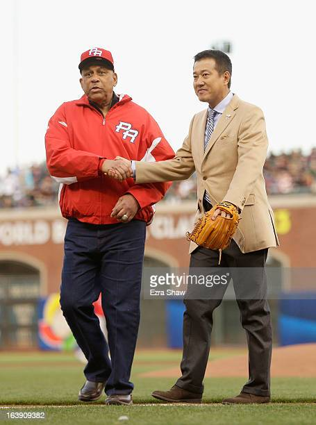 Orlando Cepeda shakes hands with Tatsunori Hara after Hara threw out the ceremonial first pitch before the semifinals of the World Baseball Classic...