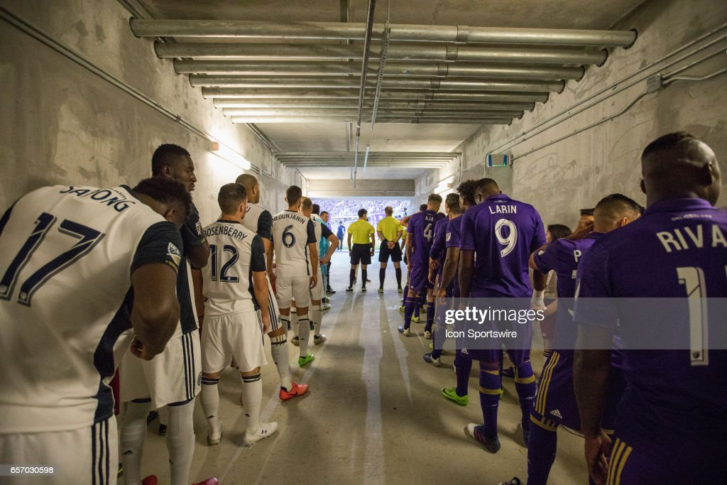 Orlando City and Philadelphia Union players wait for player introductions before the soccer match between the Orlando City Lions and the Philadelphia Union on March 18, 2017 at Orlando City Stadium in Orlando, FL.