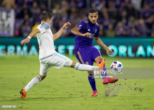 Orlando City defender Amro Tarek trys to block the pass of Orlando City defender Mohamed ElMunir during the MLS Soccer match between Orlando City SC...