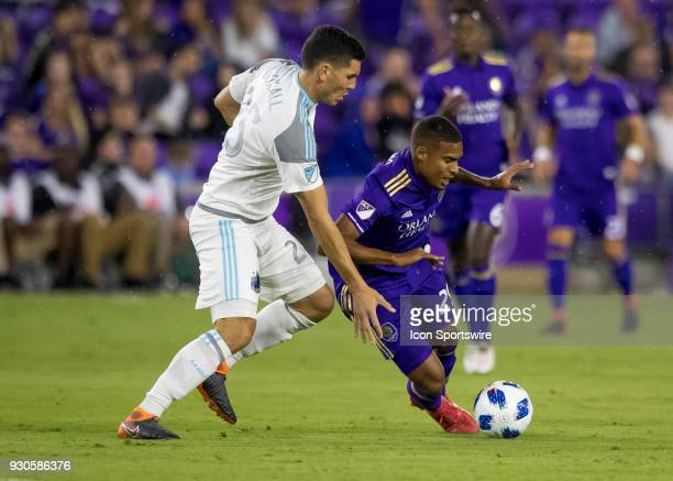 Orlando City defender Donny Toia gets fouled by Minnesota United defender Michael Boxall during the MLS Soccer match between Orlando City SC and...