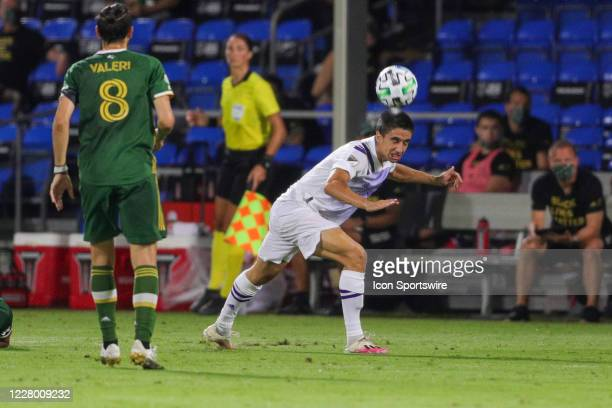Orlando City defender Joao Moutinho executes a header during the MLS is Back Final between the Orlando City Lions and the Portland Timbers on August...