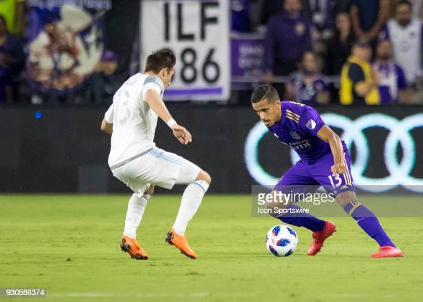 Orlando City defender Mohamed ElMunir looks to beat Minnesota United midfielder Ethan Finlay during the MLS Soccer match between Orlando City SC and...
