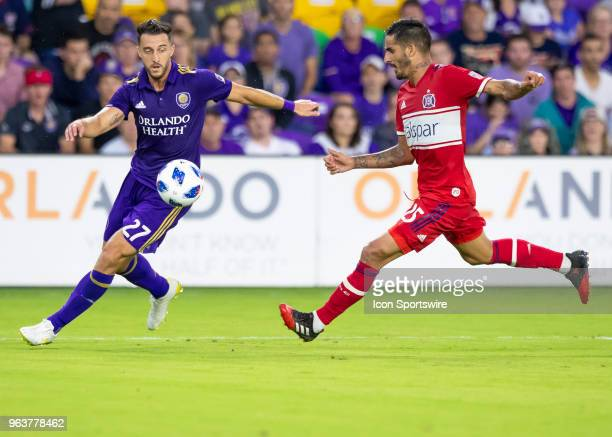 Orlando City defender RJ Allen looks to cross the ball during the MLS soccer match between the Orlando City and the Chicago Fire on May 26th 2018 at...