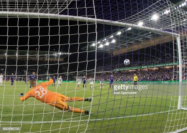 Orlando City defender Yoshimar Yotun scores a PK Goal as Minnesota United goalkeeper Matt Lampson dives the wrong way during the MLS Soccer match...
