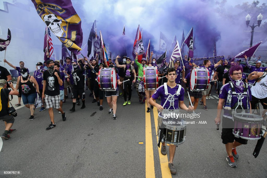 Orlando City fans march pre match during the MLS match between Atlanta United and Orlando City at Orlando City Stadium on July 21, 2017 in Orlando, Florida.