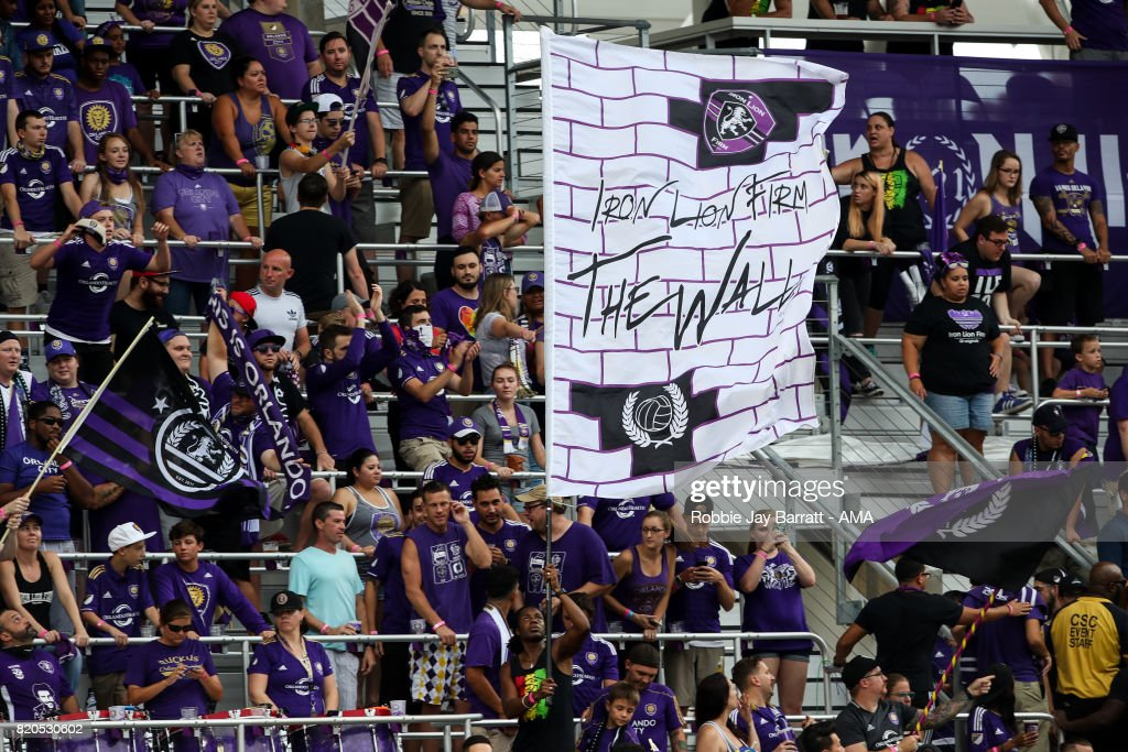 Orlando City fans wave a flag saying The Wall during the MLS match between Atlanta United and Orlando City at Orlando City Stadium on July 21, 2017 in Orlando, Florida.