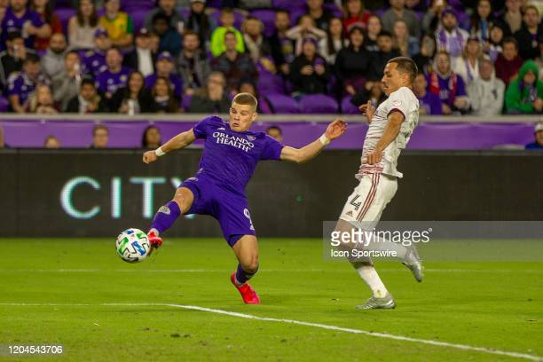 Orlando City forward Chris Mueller kicks the ball past Real Salt Lake defender Donny Toia during the soccer match between Real Salt Lake and Orlando...
