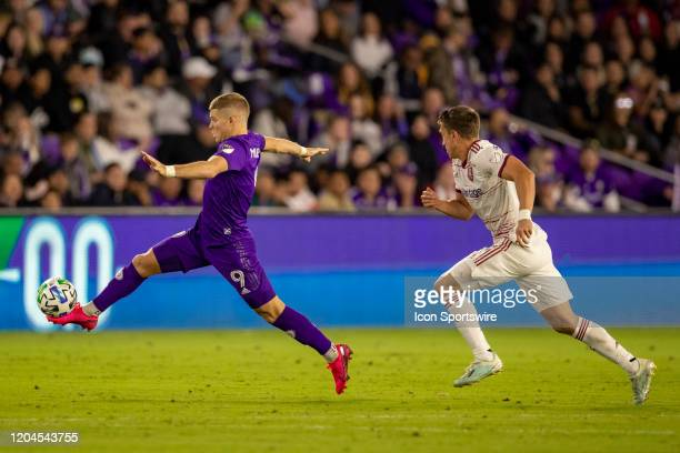 Orlando City forward Chris Mueller reaches out and stops the ball during the soccer match between Real Salt Lake and Orlando City SC on February 29...