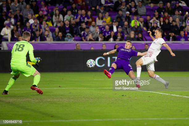 Orlando City forward Chris Mueller takes a shot on goal that is blocked by Real Salt Lake goalkeeper Zac MacMath during the soccer match between Real...