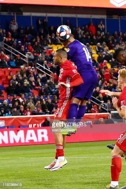 Orlando City forward Dom Dwyer goes up over New York Red Bulls defender Amro Tarek for a head ball during the second half of the Major League Soccer...