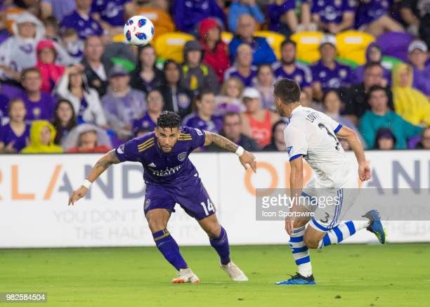 Orlando City forward Dom Dwyer heads the ball During the MLS soccer match between the Orlando City SC and Montreal Impact on June 23rd 2018 at...