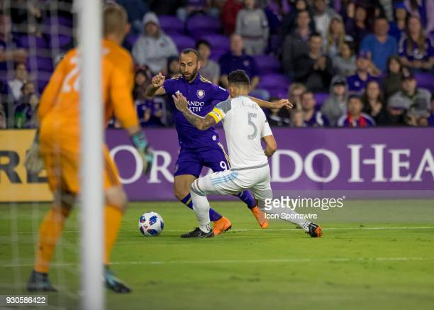 Orlando City forward Justin Meram looks to cross the ball during the MLS Soccer match between Orlando City SC and Minnesota United FC on March 10th...