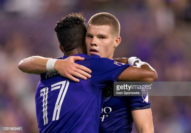 Orlando City forward Nani and Orlando City forward Chris Mueller celebrate the first goal of the game during the MLS Preseason soccer match between...