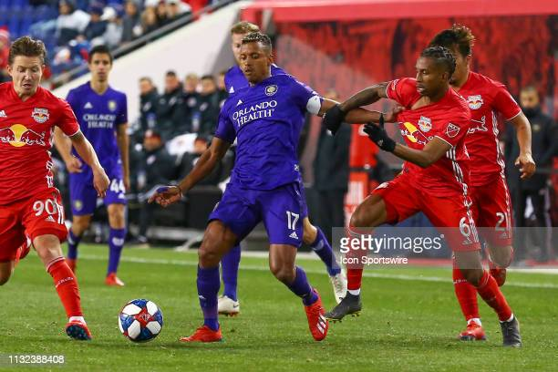 Orlando City forward Nani battles New York Red Bulls defender Kyle Duncan during the second half of the Major League Soccer game between the York Red...