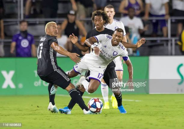 Orlando City forward Nani gets fouled by Sporting Kansas City forward Gianluca Busio during the MLS soccer match between the Orlando City SC and...
