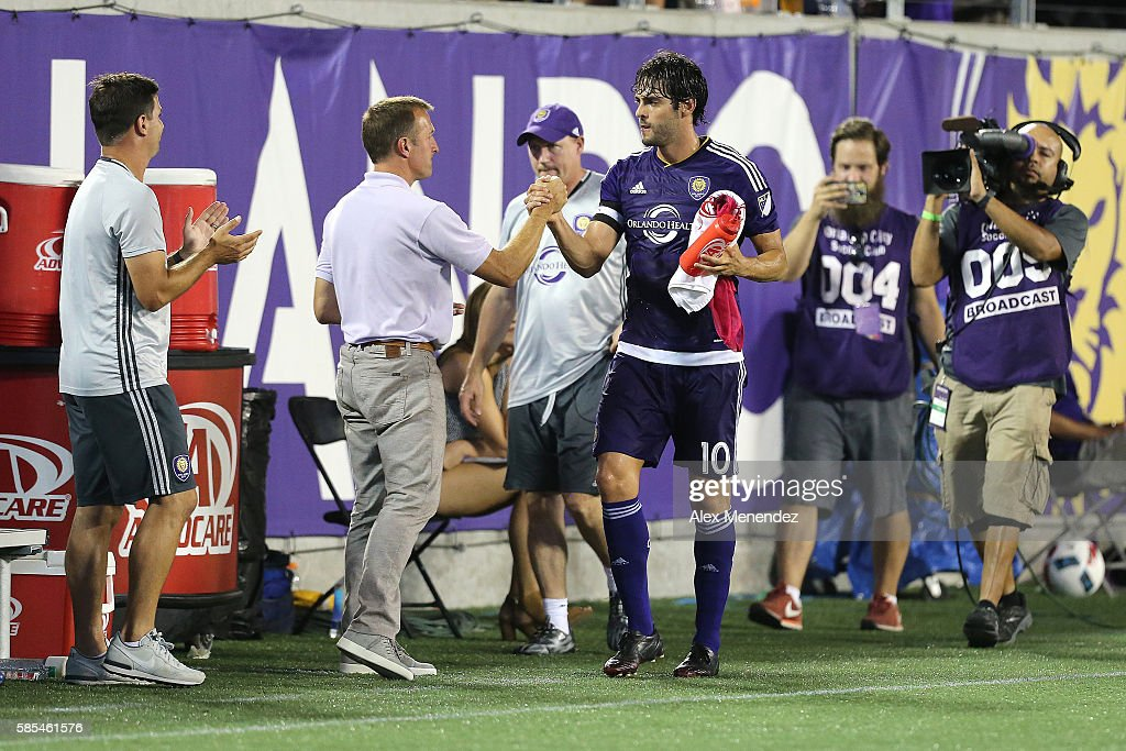Orlando City head coach Jason Kreis is seen on the sideline with Kaka #10 during a MLS soccer match at Camping World Stadium on July 31, 2016 in Orlando, Florida.