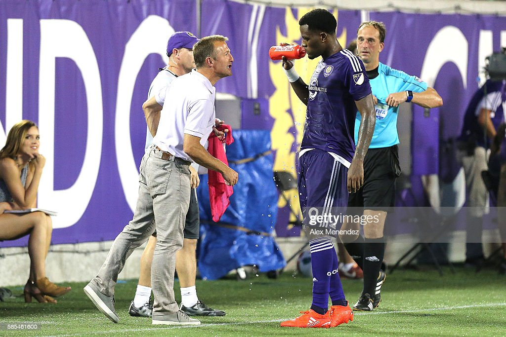Orlando City head coach Jason Kreis speaks with Cyle Larin on the sideline during a MLS soccer match at Camping World Stadium on July 31, 2016 in Orlando, Florida.