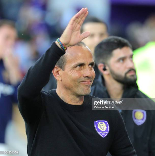 Orlando City head coach Oscar Pareja waves to fans during the team's season opener against Real Salt Lake at Exploria Stadium in Orlando Fla on...