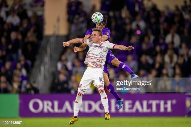 Orlando City midfielder João Moutinho and Real Salt Lake forward Corey Baird go up for a header during the soccer match between Real Salt Lake and...