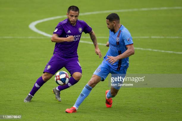 Orlando City midfielder Josue Colman and New York City defender Alexander Callens go for the ball during the soccer match between NYCFC and Orlando...