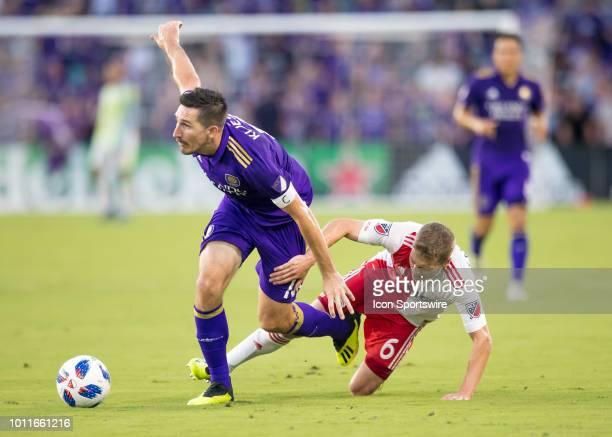 Orlando City midfielder Sacha Kljestan beats New England Revolution midfielder Scott Caldwell to the ball during the MLS soccer match between the...
