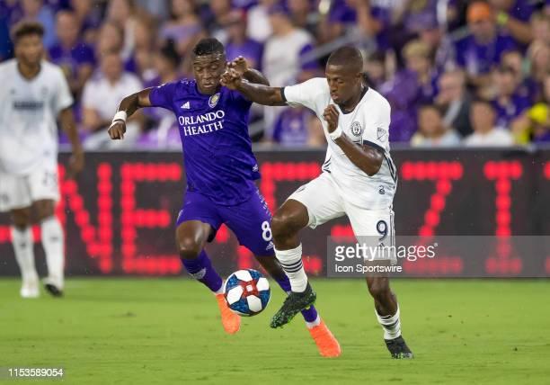 Orlando City midfielder Sebas Mendez challenges Philadelphia Union forward Fafa Picault during the MLS soccer match between the Orlando City SC and...