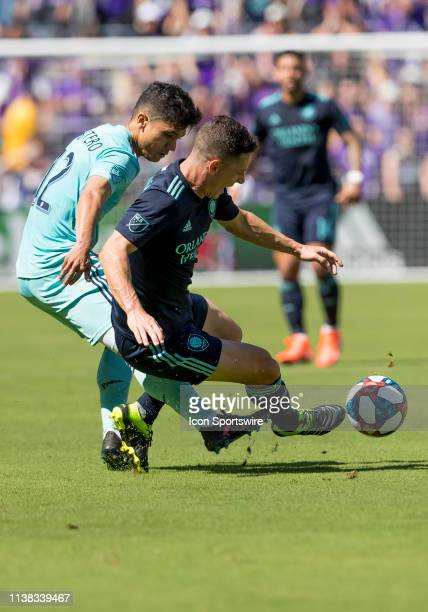 Orlando City midfielder Will Johnson and Vancouver Whitecaps forward Fredy Montero during the MLS soccer match between the Orlando City SC and...